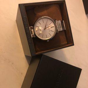 Women's silver Michael Kors watch